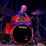 Roy Adams on red Yamaha drum kit