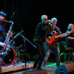 Climax Blues Band performing live with sax player and singer front centre