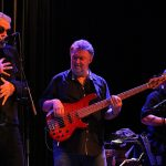 Climax Blues Band performing live with singer and bass player front centre