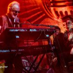 George Glover plays keyboards with big smile and Graham Dee admires